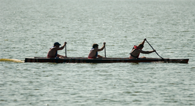 graphic of people rowing boat